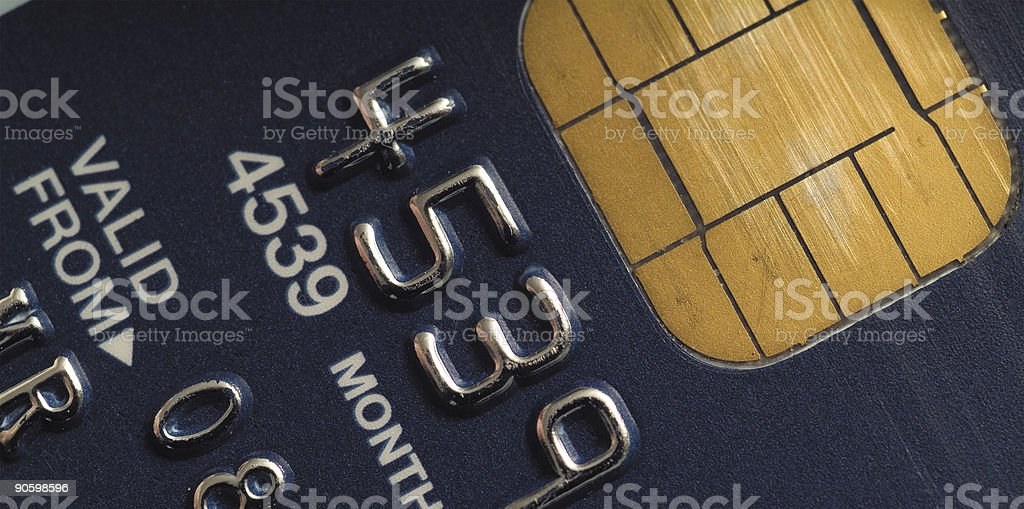 Close-up to a black credit card's chip stock photo