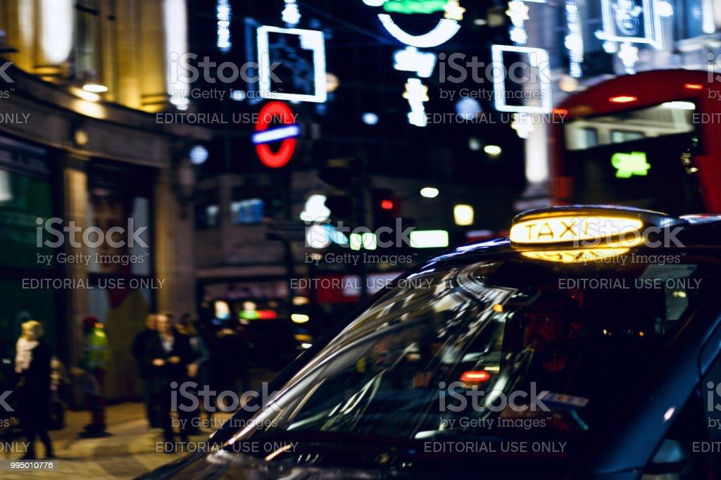 ロンドン タクシー サインにクローズ アップ ストックフォト