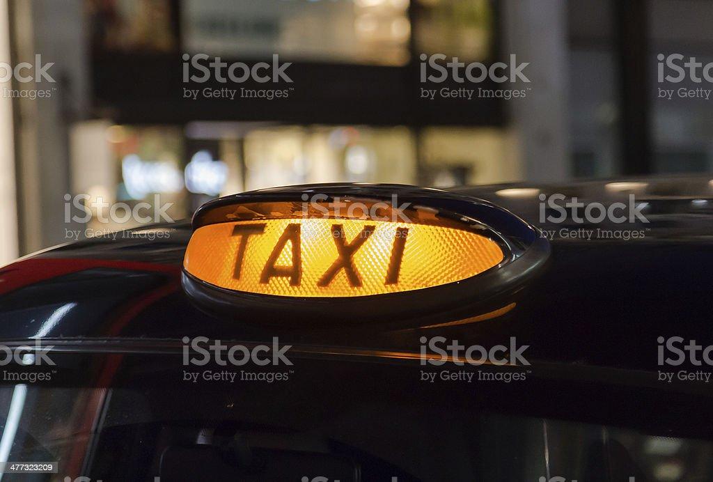 Closeup to a Taxi Sign stock photo