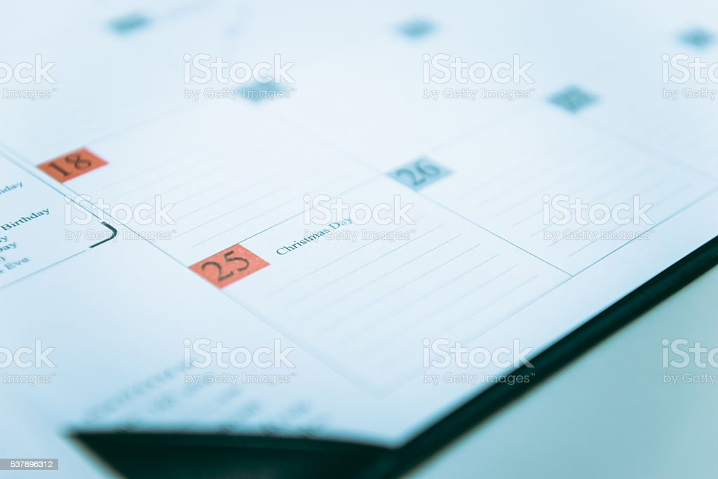 Closeup to December 25 on a calendar Schedule stock photo