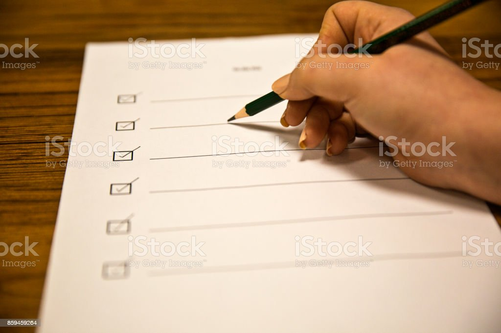young woman hand checking to do list