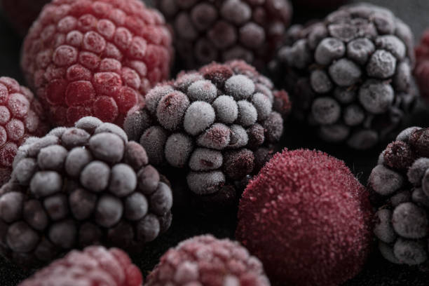 close-up to frozen berry fruit - frozen berries stock photos and pictures