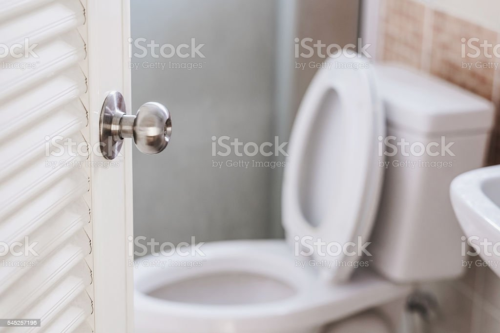 Close-up, Toilet door, with stationery, selective focus on door knob stock photo