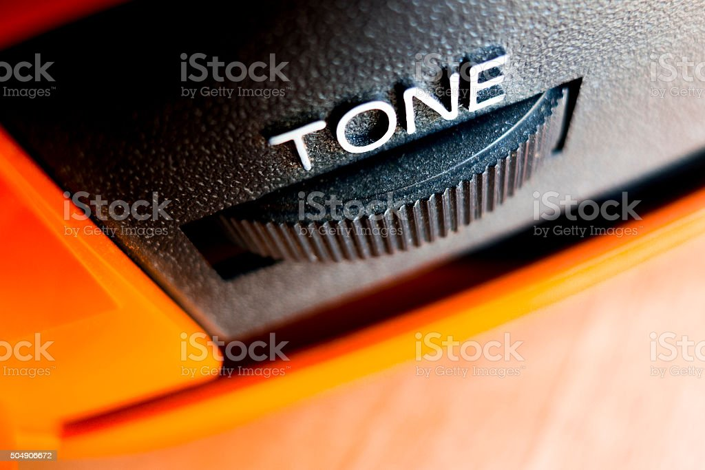 Close-up tone knob on a vintage record player stock photo