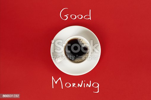 istock Close-up top view of cup of fresh hot coffee and good morning inscription 866531232