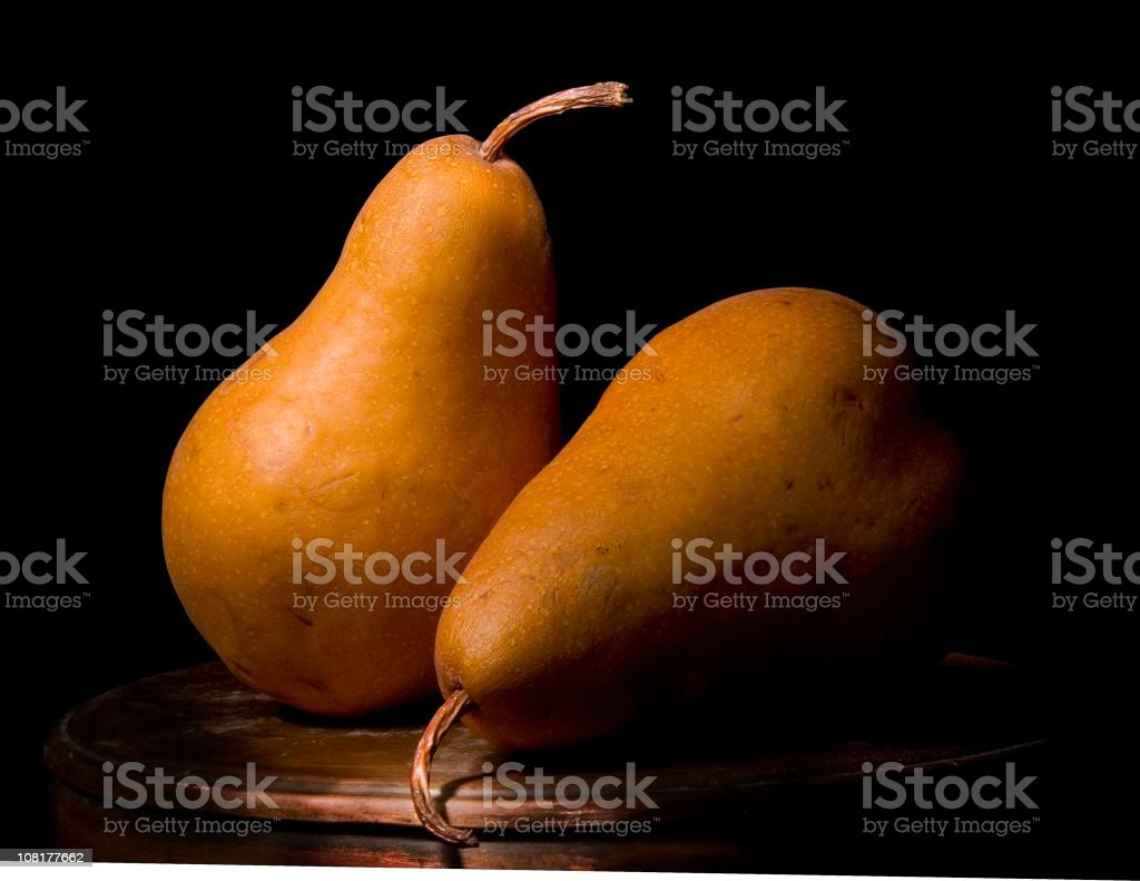 Close-up Two Bosc Pears-Still Life, Low Key stock photo