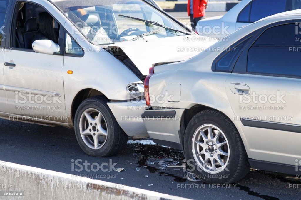 Closeup two cars in a car accident on street stock photo