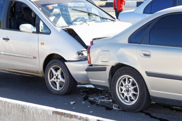 closeup two cars in a car accident on street - car accident stock photos and pictures