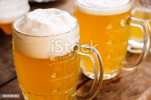 istock Close-up two cold beers with foam and drops. 945598062