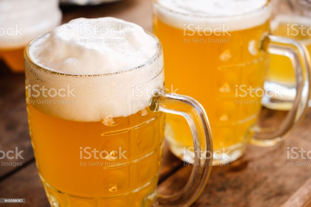Close-up two cold beers with foam and drops. stock photo