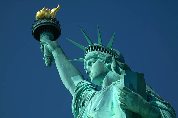 A closeup, upward pointing view of the Statue of Liberty stock photo