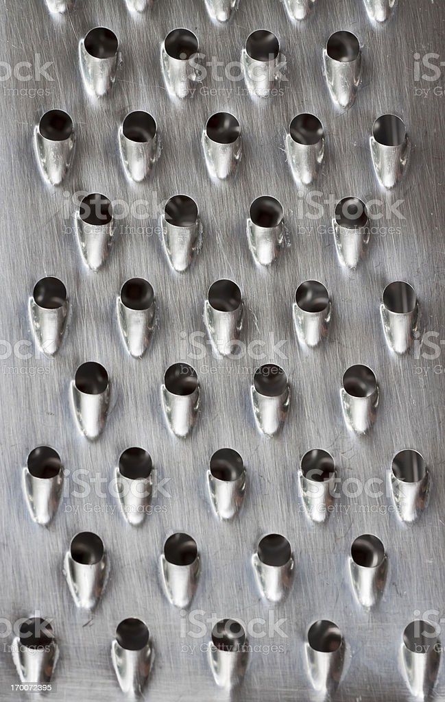 Closeup used shiny metal grater royalty-free stock photo