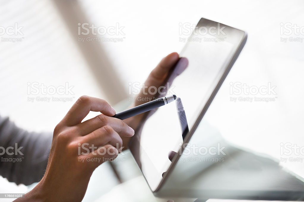 Close-up using tablet pc with digitized pen stock photo