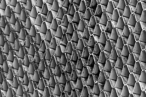 istock Closeup ventilated facade of building. White ventilation with creative and beautiful pattern architecture. Exteriors architecture abstract background. Dirty ventilated facade with black stains. 1131080873