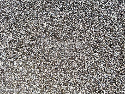 close-up view looking down at rock stone pebble and ground dirt walkway path