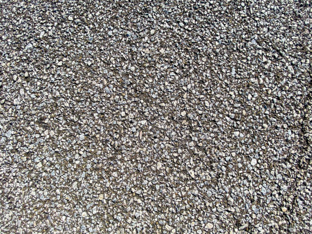 close-up view looking down at rock stone pebble and ground dirt walkway path stock photo