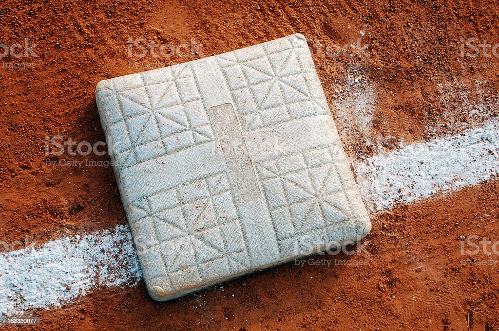 Close-up view of a baseball base on the field stock photo