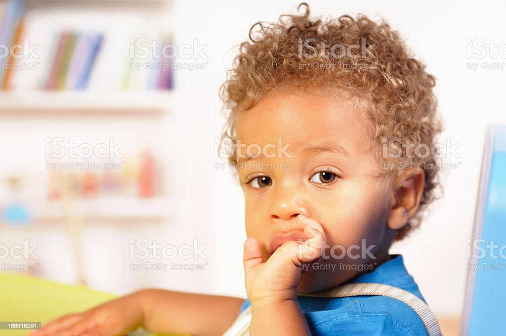 Close-up View Of A Biracial Baby/ Toddler Sucking His Finger royalty-free stock photo