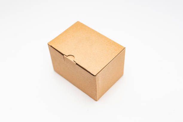 close-up view of a cardboard box over white background stock photo