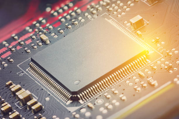 Closeup view of a central processing unit or CPU on electronic board. stock photo