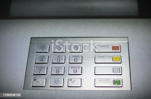 Closeup view of a generic atm keypad buttons with numbers and braille