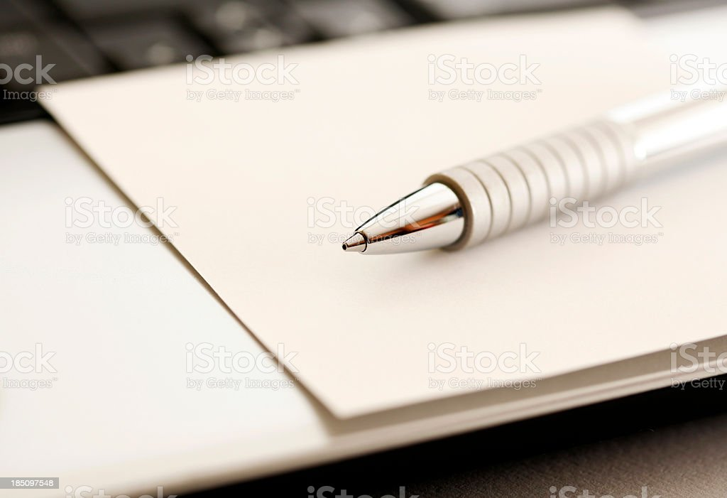 A close-up view of a metal ink pen with sepia toned image stock photo