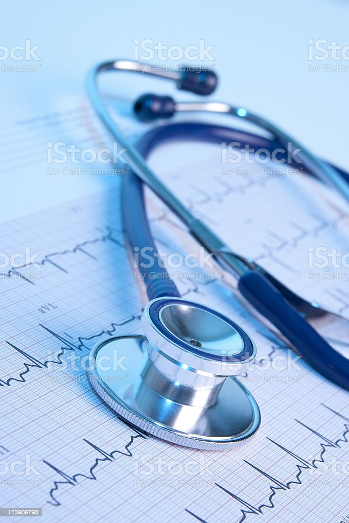 Closeup view of a stethoscope with an EKG stock photo