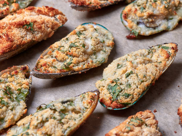 Closeup view of a tray of delicious mussels au gratin stock photo