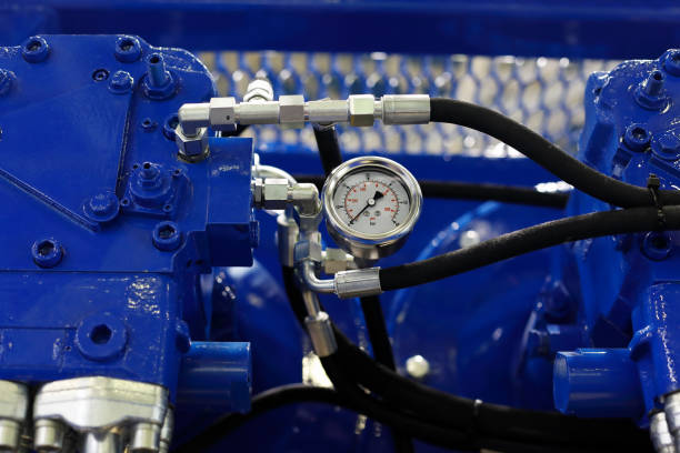 closeup view of air compressor with pressure gauge Close up view of air compressor with pressure gauge. Selective focus. compressor stock pictures, royalty-free photos & images
