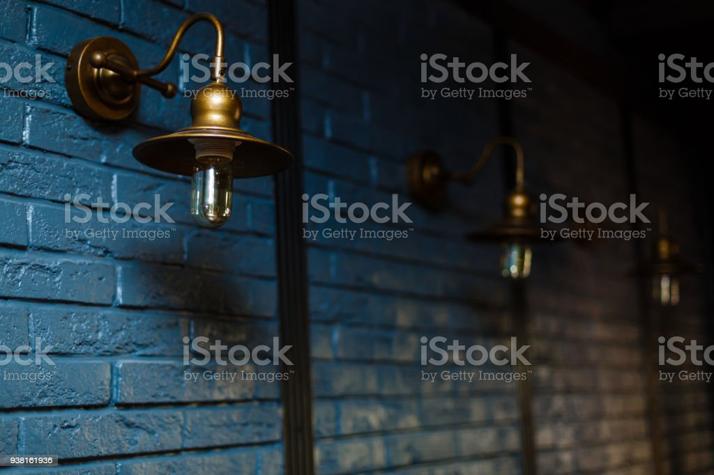 Close-up view of an antique lamp on a wall stock photo