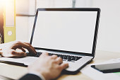 istock Closeup view of banking finance analyst working at sunny office on laptop.Blurred,horizontal mockup. 855086188