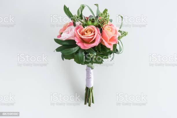 Closeup view of beautiful bouquet of roses and succulents isolated on picture id682595592?b=1&k=6&m=682595592&s=612x612&h=epivurao9tlq6doytdzmswk95o9ke2jpgozgdvlcyoc=