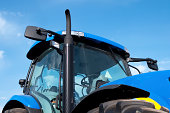 istock Close-up view of blue tractor 182720800
