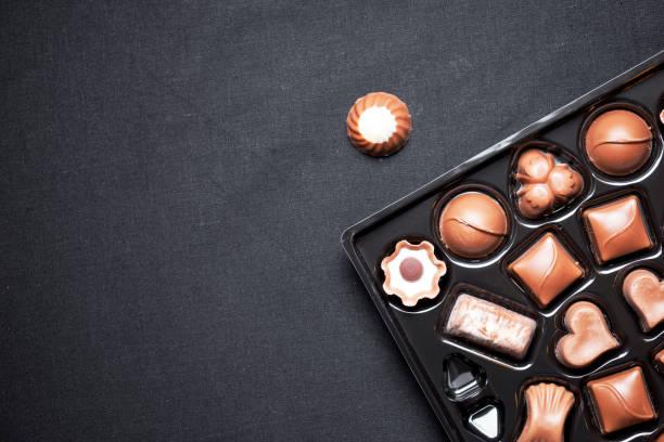 Closeup view of box of chocolates with variety chocolates pralines stock photo