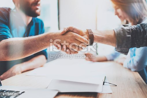 istock Closeup view of Business male partnership handshake.Photo two coworkers handshaking process.Successful deal after great meeting.Horizontal, blurred background. 912688382