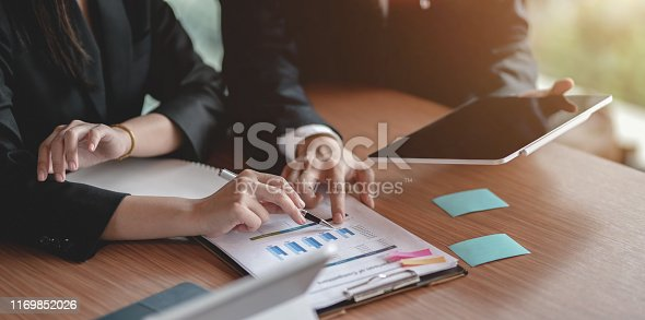1068752548istockphoto Close-up view of business partner discussing the project together 1169852026