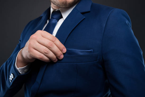 close-up view of businessman fixing his pocket square - pocket stock photos and pictures