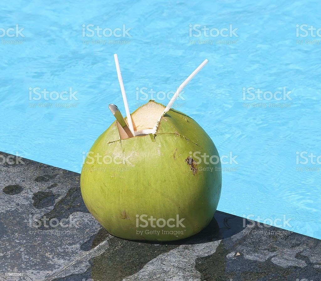 Close-up view of coconut with drinking straws royalty-free stock photo