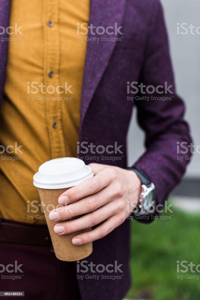 Close-up view of coffee cup in hand of stylish man - Zbiór zdjęć royalty-free (Biznes)