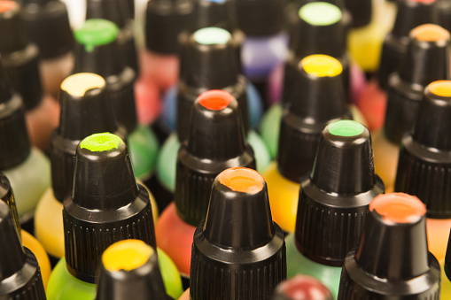 istock Closeup view of colorful paints in bottles 1038606096