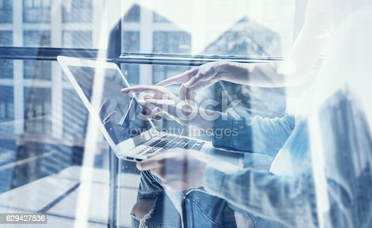 629421870 istock photo Closeup view of coworking team using modern laptop in design 629427536
