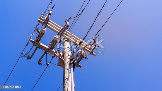 istock Close-up View of Electricity Transmission Pole and Power Cables 1137502050