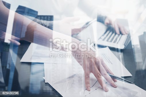 629421870 istock photo Closeup view of female hand holding a pen under the 629430296