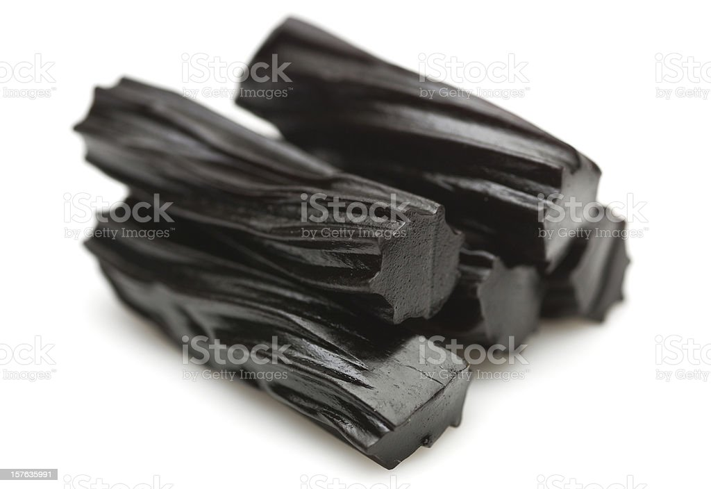 Close-up view of five pieces of licorice on white background stock photo