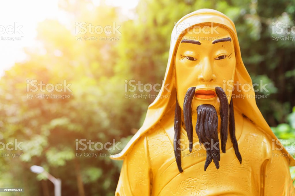 Closeup view of Golden Buddha statue in sunlight on nature background in Hong Kong royalty-free stock photo