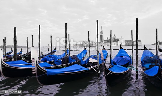 Traditional gondola boats on panoramic view of Grand canal in Venice