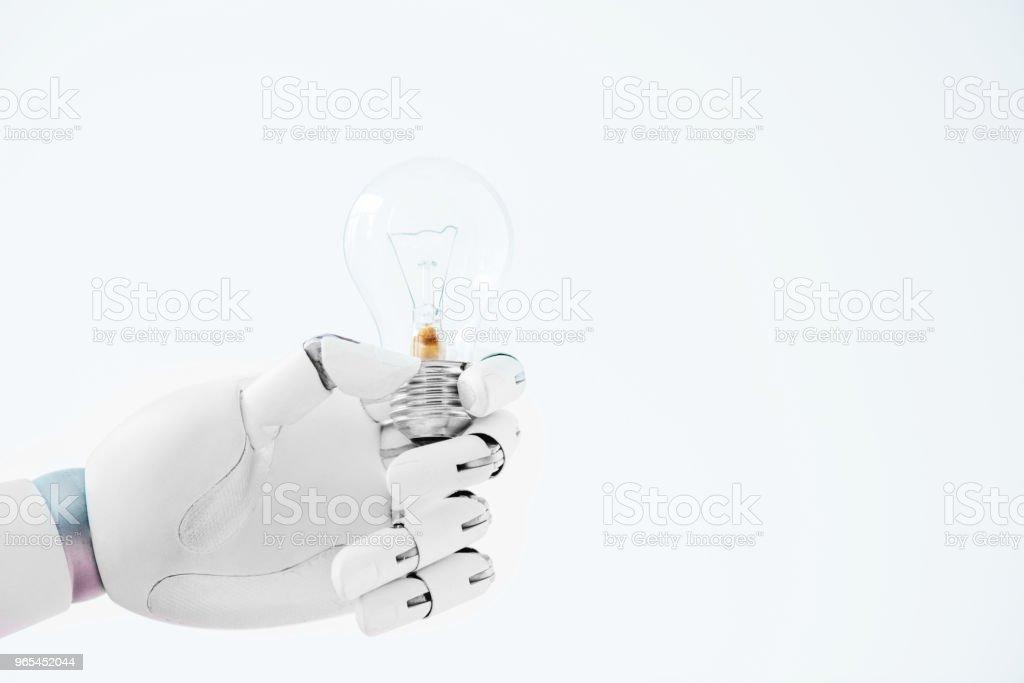 흰색 절연 전구를 들고 로봇의 손 클로즈업 보기 - 로열티 프리 0명 스톡 사진