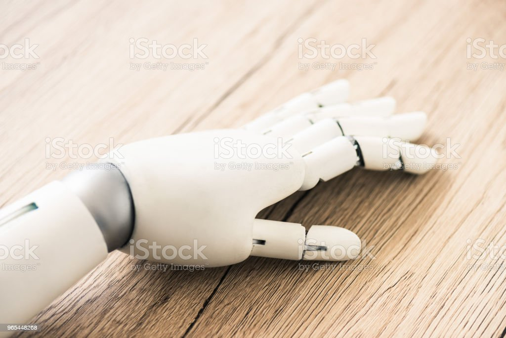 close-up view of hand of robot on wooden surface royalty-free stock photo