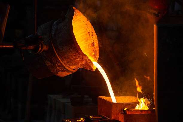 Close-up view of industrial chill casting. The process of for filling out mold with molten metal. stock photo