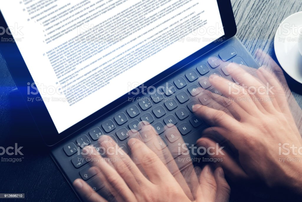 Closeup View Of Male Hands Quickly Typing On Electronic